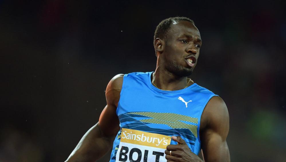 Usain Bolt durante la final de los 100 metros en Londres